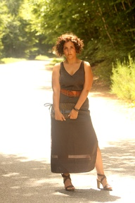 Curvy girl in a vintage brown maxi dress
