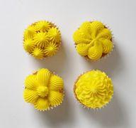 four cupcake decorat