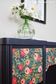 Navy desk with flowe