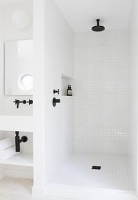 Master shower head.  Black on white, pops!  best faucets white tile shower with black shower head