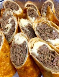 Interesting...Steak and cheese egg rolls, can be baked on 400 for about 20 minutes or until golden brown