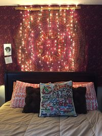 Bedroom bohemian wall tapestry and diy Christmas lights.