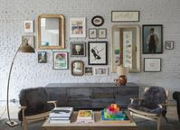 Art Walls How to Hang Art at Home | Before hanging this eclectic collection, the designers made kraft paper templates of each piece and arranged them on the floor, perfecting the grouping for hours