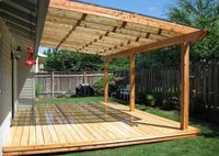 Covered Patio Ideas | Light wooden solid patio cover design with a roof window.