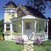 Tiny victorian cottage with wrap around porch and a