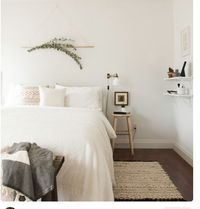 The simple hanging pole above the bed -perfect for adding florals or greenery