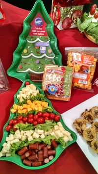 Christmas tree Cheese tray- quick & easy using a tree shaped cake pan.  Add your favorite meats and cheeses.  Garnish with leaf lettuce between the layers and you are done!