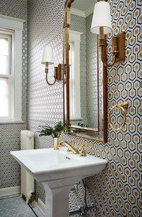 Geometric wallpaper in powder bathroom