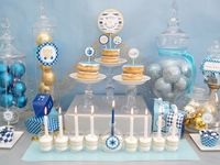 I love a festive look.  Here are some great ideas to deck out Hanukkah.
