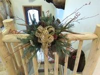 Christmas centerpieces, wreaths and wall hangings made out of pine, antlers, feathers, and misc.