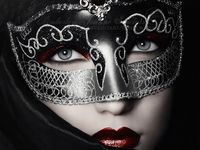 A collection of Venetian style masks, costumes and related paraphernalia and artwork.
