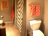 bathroom: teal, green, chocolate brown----bedroom: navy chocolate brown, and crème----kitchen: black and beige