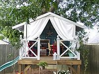 Outside playhouse and swing sets for the kids