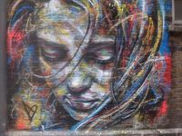 """Street art is art, specifically visual art,spaces - """"in the streets"""" The term can include traditional graffiti artwork, sculpture, stencil graffiti, sticker art, and street poster art,"""