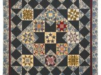 Quilt fabric as well as beautiful quilts that I would like to make some day!