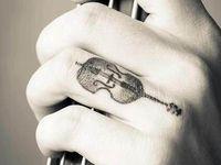 Violin tattoo & music notes