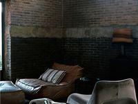 Masculine, romantic, dark, leather, books, brick, dark wood, comfortable, well-worn, man-cave...  Inspired.