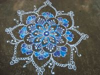 Kolam (Muggu in Telugu) is a form of sand painting that is drawn using rice powder by (traditionally female) members of the family in front of their home. It is widely practiced by Hindus in South India. A kolam is a sort of painted prayer.