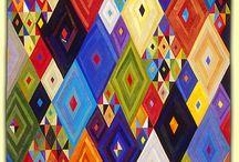 Mundo dos têxteis / by Maria Helena Trindade