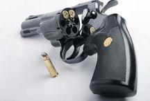 Guns / by Cody Crabtree