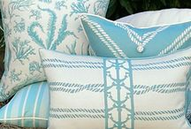 Karen Robertson Pillow Collection / The Karen Robertson Collection has expanded as we introduce more colors and patterns. Royalty, our premiere color of Classic Navy & Ivory is now joined by the Invigorating Turquoise of Baltic, the Sandy Beige tones of Dune and the Ice Blue Waters of Cayo. So wether your poolside lounging, dining on the porch, or out on the water, this outdoor collection is sure to give your setting all the style and comfort for anywhere you may live.  / by Outer Banks Trading Group, Inc.