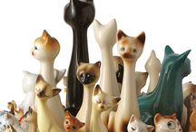 Vintage Cats and Dogs / I love these little statues. I had a collection of them growing up. / by Vicki Hutton