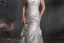 Plus Size Dresses / by WeddingDresses.com