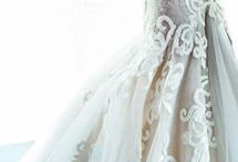 Romantic Dresses / They will be envious when you walk down the aisle in this flowy, dreamy, yet sultry dress / by WeddingDresses.com
