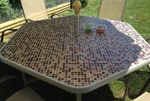 Refurbished  Outside Glass Patio Table into Tile top project / We refurbished a broken glass patio table into this beautiful tile table. using the existing metal frame as a template we cut some waterproof tile board (found in DIY Stores ) as a under layer. Then used special adhesive used for outside tiling. The small tiles were on 12 x 12 tile sheets / by Maria Zingas