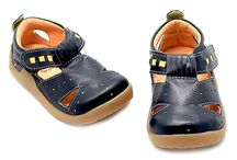 Shoes for Sebastian  / by Lucy Moloney