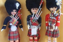 Souvenir Dolls / Dolls collected while on vacations / by Anne deFuria