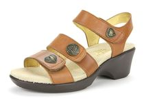 Alegria Olivia / The Alegria Olivia sandal features the career fashion lightweight outsole with a low profile wedge heel. Loaded with cork and memory foam, the footbed forms to the natural contours of your foot. Three unique button details hide three adjustable velcro closures. The Alegria Olivia provides stylish work to play comfort and support! / by Alegria Shoe Shop