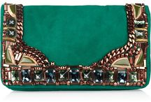 Bags, purses, clutches  / by Leanna Majors