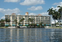 Yacht & Beach Club Condo / Yacht & Beach Club condo is casual, tropical, carefully maintained and well suited for upscale business and vacation travelers (all apartments are two-bedroom/two bath). It offers a relaxing get-away that's close to everything. You'll find a beautiful, heated swimming pool right on the Intracoastal Waterway where you can spend the day or evening watching the passing yachts. Enjoy the view of our marina from your living room and balcony. / by Beach Vacation Rentals