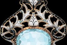 Art Nouveau and Art Deco Jewelry / Jewelry is a passion.  I want to possess all of it.  Just to look at and hold.  / by Ann Syphers