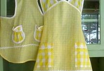 Aprons / Apron styles have come a long way since Grandmother's apron, but all are wonderful. Vintage aprons still tug at heartstrings. Come stay enveloped in grandma's apron, or find ideas to create your own.  / by Candy Rick