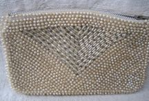 Clutch / Pick one that you don't hate and that matches your dress. Some are white, gold, silver, or combinations of those colors.  / by Maria Elisabeth