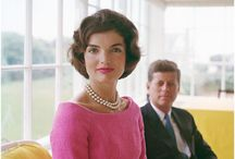 JFK and Jackie / It's true! It's true! The crown has made it clear. The climate must be perfect all the year.  A law was made a distant moon ago here: July and August cannot be too hot. And there's a legal limit to the snow here In Camelot. The winter is forbidden till December And exits March the second on the dot. By order, summer lingers through September In Camelot. Camelot! Camelot! I know it sounds a bit bizarre, But in Camelot, Camelot That's how conditions are. The rain may never fall till after sundown. By eight, the morning fog must disappear. In short, there's simply not A more congenial spot For happily-ever-aftering than here In Camelot.  Camelot! Camelot! I know it gives a person pause, But in Camelot, Camelot Those are the legal laws. The snow may never slush upon the hillside. By nine p.m. the moonlight must appear. In short, there's simply not A more congenial spot For happily-ever-aftering than here In Camelot. / by Eire Sicilia