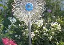Garden Of Glass / Gorgeous garden constructed entirely of glass! No watering required. DIY instructions for creating your own glass flowers. / by Susan@CountryDesignHome