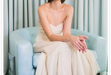 Boat Bridal Shoot / Big nice yacht. Hair style a little vintage updo. Blue and while colors. A tan suit groom or black with accents of blue. Short lace dress with long veil.  / by Julianna Rennard