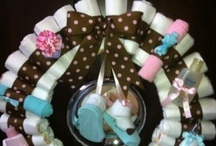 Diaper cakes and wreaths / by Bettina Ireland