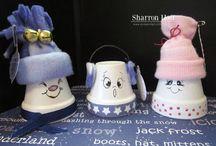 Christmas terra pots / by Jeannie Dellinger