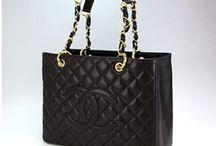 Black hand bags / by Angela