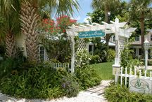 Cottages by the Ocean / Cottages by the Ocean is a small, well-kept property of charming Key West-style studio and one-bedroom cottages. We are a White Glove award-winner and nationally rated as a Superior Small Lodging. Each restored 1940s cottage has a full kitchen, king or queen bed and sleeper sofa, lush, tropical garden views, large screened-in porches or open patio, private BBQ grills, with a central sundeck and coin laundry on site. / by Beach Vacation Rentals