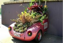 Recycled wheels / Recycled cars, unusual planting containers / by Jo Wiles