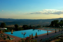 """Swimming Pool & Relax Area / The pools area, with infinity pool of 10 x 18 meter, wading pool of 4 x 8 meters and solarium, is located on a terrace that offers a breathtaking view on the hills of Val di Cecina that border the sea.  Our nice Relax Area """"Ebe"""" is equipped with sauna, whirlpool and """"emotional showers"""". By appointment you can also enjoy massage and beauty treatments with our qualified beautician collaborator. / by Park Hotel le Fonti"""