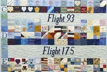 National Tribute Quilt / The National Tribute Quilt represents the response of the Steel Quilters of United States Steel Corporation to the events of September 11, 2001. The four central panels form a montage of the twin towers of the World Trade Center against the New York City skyline. These are flanked by panels dedicated to the lives extinguished on the four flights and at the Pentagon. Each three-inch-square block bears the name of one person who perished in the disaster. The quilt was completed on July 4, 2002.   / by American Folk Art Museum