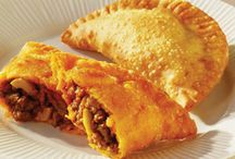 Food - Empanadas / Made all over central and south america. They can be baked or fried, small enough for appetizers or hand size or the size of a calzone, They can be savory or sweet. / by Sandy Vaughan