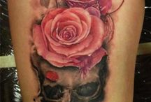 Skulls and Roses Tattoos / Dark and light.  Death and life.  Skulls and roses! / by Rebel Circus