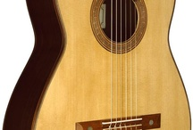 classical guitars we play / by Flores Design Studio